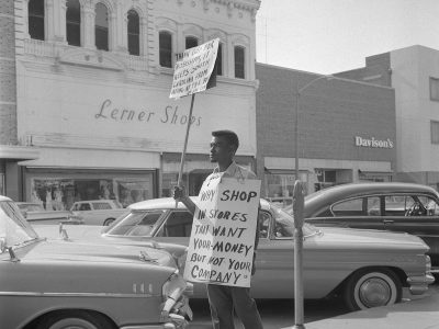 Demonstrator on Main. St. (Courtesy of Cecil J Williams)